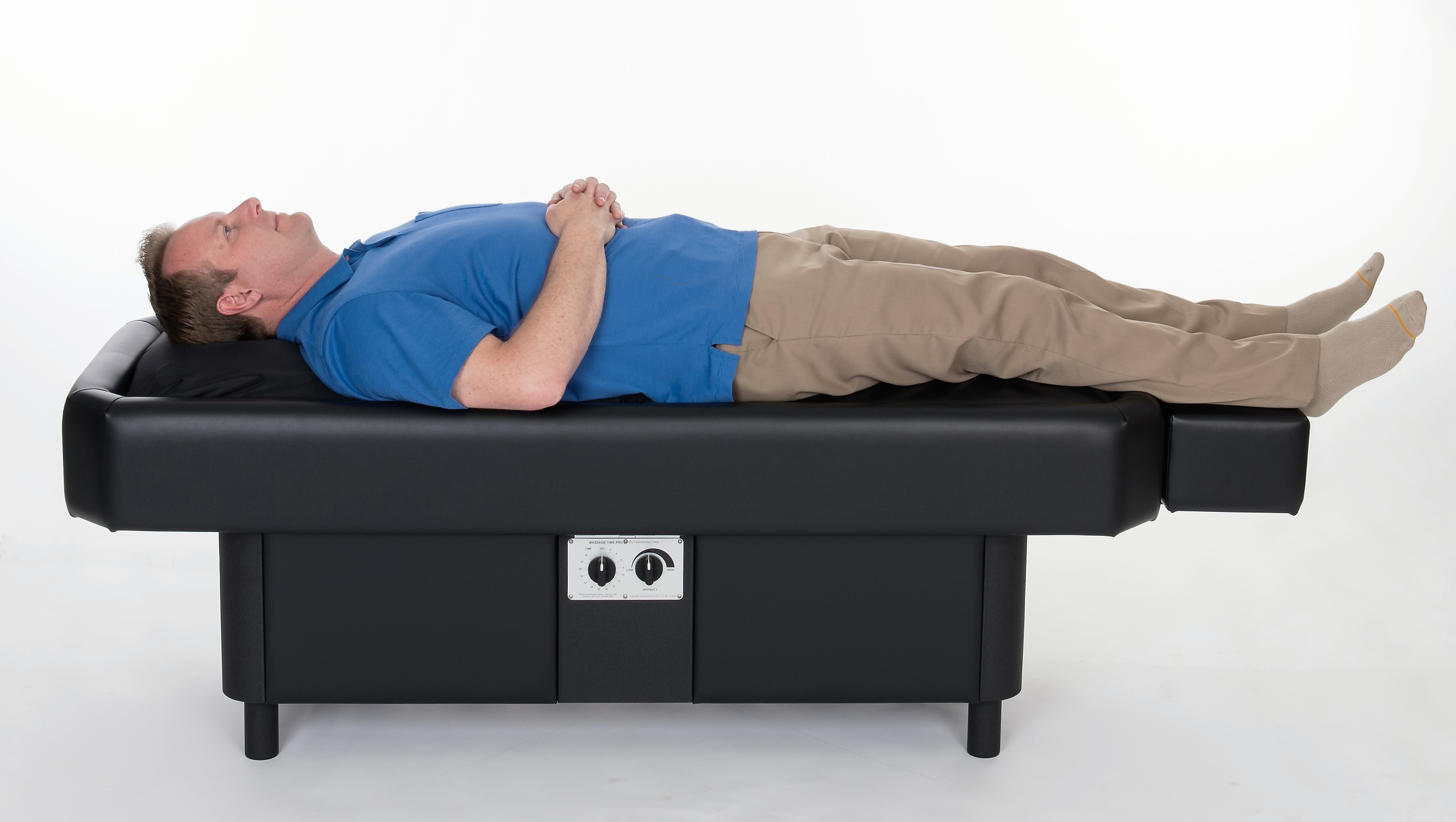 man lying on hydromassage table