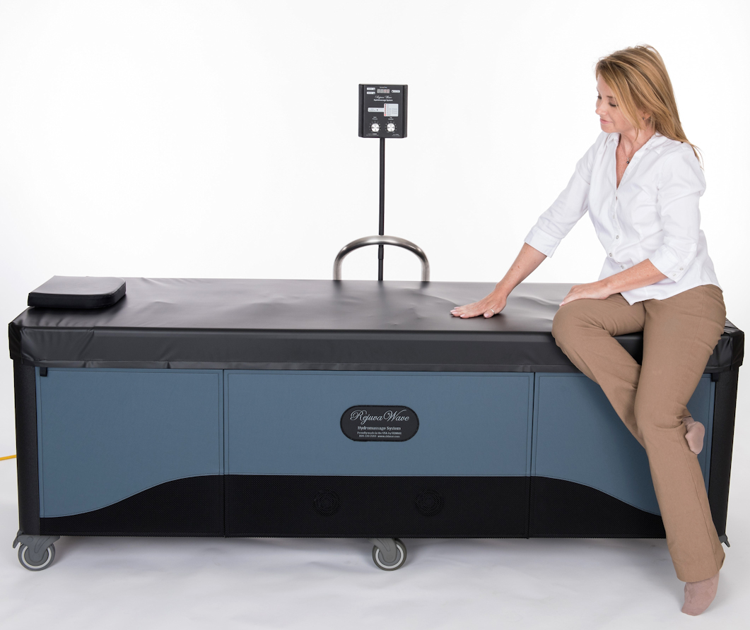 woman sitting on rejuvawave hydromassage table